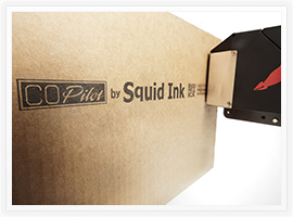Squid Ink's CoPilot Printing System printing on a corrugated box